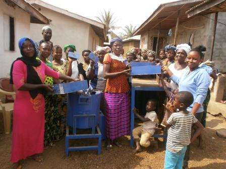 Handing over machine to Peace Mothers