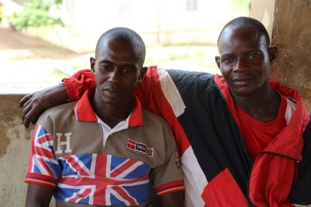Nyuma(left) and Sahr attend post ebola community preparedness meeting in Kangama town